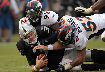 Carson Palmer takes a sack at the hands of the Denver Broncos