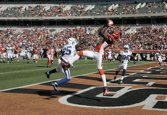 CINCINNATI, OH - OCTOBER 16:  A.J.Green #18 of the Cincinnati Bengals makes a touchdown catch against Jerraud Powers #25 of the Indianapolis Colts during their game at Paul Brown Stadium on October 16, 2011 in Cincinnati, Ohio.  (Photo by John Grieshop/Ge
