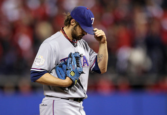ST LOUIS, MO - OCTOBER 28:  C.J. Wilson #36 of the Texas Rangers stands on the mound in the sixth inning during Game Seven of the MLB World Series against the St. Louis Cardinals at Busch Stadium on October 28, 2011 in St Louis, Missouri.  (Photo by Ezra