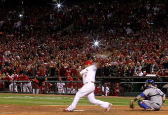 ST LOUIS, MO - OCTOBER 28:  Albert Pujols #5 of the St. Louis Cardinals strikes out in the seventh inning during Game Seven of the MLB World Series against the Texas Rangers at Busch Stadium on October 28, 2011 in St Louis, Missouri.  (Photo by Ezra Shaw/