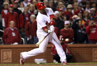 ST LOUIS, MO - OCTOBER 27: Albert Pujols #5 of the St. Louis Cardinals hits a double in the ninth inning during Game Six of the MLB World Series against the Texas Rangers at Busch Stadium on October 27, 2011 in St Louis, Missouri.  (Photo by Jamie Squire/