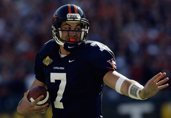 CHARLOTTE, NC - DECEMBER 27:  Quarterback Matt Schaub #7 of the Pittsburgh Panthers runs the ball against the Virginia Cavaliers during the Continental Tire Bowl on December 27, 2003 at Ericsson Stadium in Charlotte, North Carolina.  Virginia won 23-16.