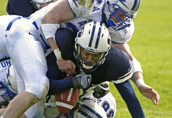 PROVO, UT - OCTOBER 29:  John Rabold #32 and Brad Meissen #36 of Air Force tackle Michael Reed (C) of Brigham Young University during the second quarter October 29, 2005 at LaVell Edwards Stadium in Provo, Utah.  (Photo by George Frey/Getty Images)