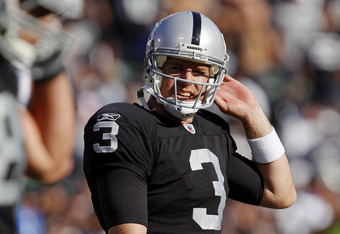 OAKLAND, CA - OCTOBER 23:  Quarterback Carson Palmer #3 of the Oakland Raiders reacts as he heads to the sidelines after throwing another interception in the fourth quarter against the Kansas City Chiefs on October 23, 2011 at O.co Coliseum in Oakland, Ca