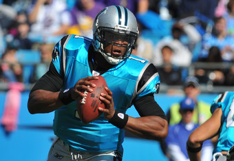 CHARLOTTE, NC - OCTOBER 30:  Quarterback Cam Newton #1 of  the Carolina Panthers sets to pass against the Minnesota Vikings October 30, 2011 at Bank of America Stadium in Charlotte, North Carolina.  (Photo by Al Messerschmidt/Getty Images)