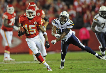 KANSAS CITY, MO - OCTOBER 31:  Wide receiver Steve Breaston #15 of the Kansas City Chiefs rushes for a first down past defensive back Marcus Gilchrist #38 of the San Diego Chargers for a first down, during overtime on October 31, 2011 at Arrowhead Stadium