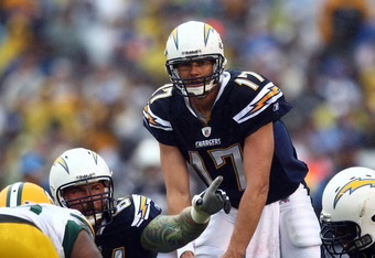 SAN DIEGO, CA - NOVEMBER 6:  Quarterback Philip Rivers #17 of the San Diego Chargers at the line of scrimmage during the game against the Green Bay Packers on November 6, 2011 at Qualcomm Stadium in San Diego, California.  (Photo by Donald Miralle/Getty I