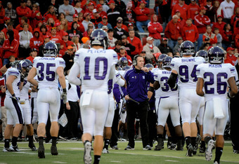 LINCOLN, NE - NOVEMBER 05: Coach Pat Fitzgerald of the Northwestern Wildcats congratulates his team as the final seconds tick away from  their game against the Nebraska Cornhuskers at Memorial Stadium November 5, 2011 in Lincoln, Nebraska.  Northwestern b