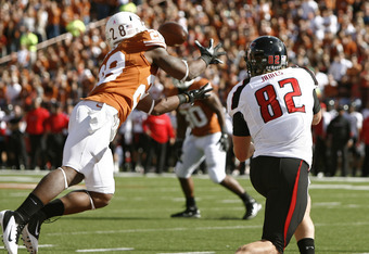 AUSTIN, TX - NOVEMBER 5: Cornerback Quandre Diggs #28 of the Texas Longhorns just misses a first quarter interception in the end zone against wide receiver Adam James #82 of the Texas Tech Red Raiders on November 5, 2011 at Darrell K. Royal-Texas Memorial