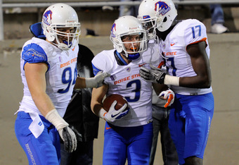 LAS VEGAS, NV - NOVEMBER 05:  (L-R) Byron Hout #94, Chris Potter #3 and Geraldo Boldewijn #17 of the Boise State Broncos celebrate what they thought was a touchdown by Potter on a play that was called back on a Boise State penalty during their 48-21 win o