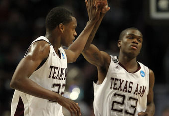 CHICAGO, IL - MARCH 18:  Khris Middleton #22 of the Texas A&M Aggies celebrates with teammate Naji Hibbert #23 after making a three-pointer at the buzzer in the first half of the game against the Florida State Seminoles during the second round of the 2011
