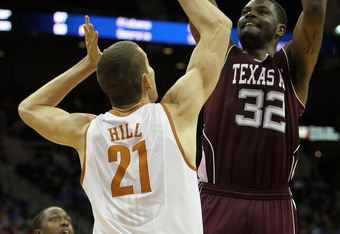 KANSAS CITY, MO - MARCH 11:  Kourtney Roberson #32 of the Texas A&M Aggies goes up for a shot against Matt Hill #21 of the Texas Longhorns during their semifinal game in the 2011 Phillips 66 Big 12 Men's Basketball Tournament at Sprint Center on March 11,