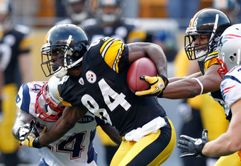 PITTSBURGH, PA - OCTOBER 30:  Antonio Brown #84 of the Pittsburgh Steelers returns the ball on the opening kick off against Kyle Arrington #24 of the New England Patriots at Heinz Field on October 30, 2011 in Pittsburgh, Pennsylvania.  (Photo by Gregory S