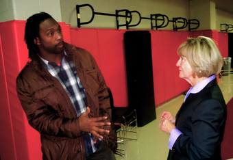 Chicago Bears cornerback Charles Tillman talks to U.S. Congresswoman Judy Biggert (R-13th) after playing Financial Football with Bolingbrook High School students.
