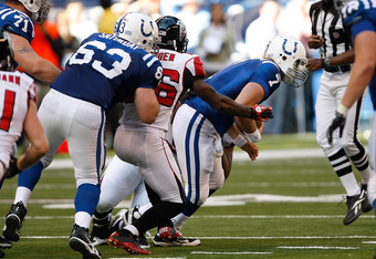 INDIANAPOLIS, IN - NOVEMBER 6: Curtis Painter #7 of the Indianapolis Colts is sacked during the game against the Atlanta Falcons at Lucas Oil Stadium on November 6, 2011 in Indianapolis, Indiana. (Photo by Scott Boehm/Getty Images)