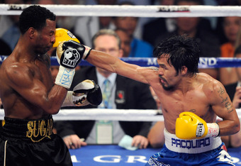 LAS VEGAS, NV - MAY 07:  Manny Pacquiao (R) hits Shane Mosley in the seventh round of their WBO welterweight title fight at the MGM Grand Garden Arena May 7, 2011 in Las Vegas, Nevada. Pacquiao retained his title with a unanimous-decision victory.  (Photo