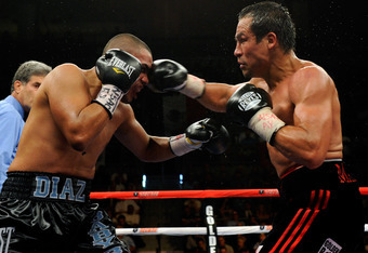 LAS VEGAS - JULY 31:  WBA/WBO lightweight champion Juan Manuel Marquez (R) hits Juan Diaz in the ninth round of their bout at the Mandalay Bay Events Center July 31, 2010 in Las Vegas, Nevada. Marquez retained his WBA and WBO lightweight championship belt