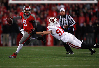COLUMBUS, OH - OCTOBER 29:  Braxton Miller #5 of the Ohio State Buckeyes breaks a tackle by Brendan Kelly #97 of the Wisconsin Badgers during the fourth quarter on October 29, 2011 at Ohio Stadium in Columbus, Ohio. Ohio State defeated Wisconsin 33-29.(Ph