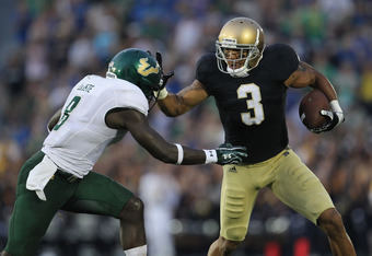 SOUTH BEND, IN - SEPTEMBER 03: Michael Floyd #3 of the Notre Dame Fighting Irish fights off  Jon Lejiste #8 of the University of South Florida Bulls at Notre Dame Stadium on September 3, 2011 in South Bend, Indiana. (Photo by Jonathan Daniel/Getty Images)