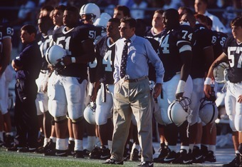 10 SEP 1994:  HEAD FOOTBALL COACH JOE PATERNO OF PENN STATE UNIVERSITY STANDS WITH HIS PLAYERS DURING A 38-14 WIN OVER USC AT UNIVERSITY PARK, PENNSYLVANIA. Mandatory Credit: Rick Stewart/ALLSPORT