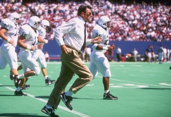 21 Sep 1996:  Head coach Joe Paterno of the Penn State Nittany Lions leads his team off the field at the close of the first half as they head to the locker room en route to the Nittany Lions 41-0 victory over the Owls at Giants Stadium in East Rutherford,