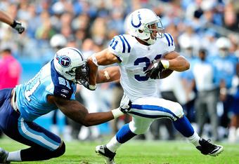 NASHVILLE, TN - OCTOBER 30:  Donald Brown #31 of the Indianapolis Colts breaks away from Jason Jones #91 of the Tennessee Titans during play at LP Field on October 30, 2011 in Nashville, Tennessee.  (Photo by Grant Halverson/Getty Images)