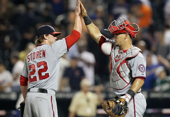 NEW YORK, NY - SEPTEMBER 12:  Drew Storen #22 and Wilson Ramos #3 of the Washington Nationals celebrate after defeating the New York Mets at Citi Field on September 12, 2011 in the Flushing neighborhood of the Queens borough of New York City.  (Photo by J