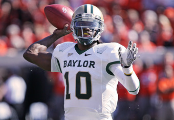 STILLWATER, OK - OCTOBER 29:  Quarterback Robert Griffin III #10 of the Baylor Bears looks to throw in the first half against the Oklahoma State Cowboys on October 29, 2011 at Boone Pickens Stadium in Stillwater, Oklahoma.  Oklahoma State defeated Baylor