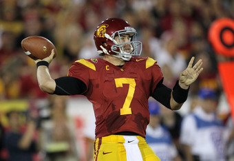 LOS ANGELES, CA - OCTOBER 29:  Matt Barkley #7 of the USC Trojans throws a pass against the Stanford Cardinal at the Los Angeles Memorial Coliseum on October 29, 2011 in Los Angeles, California.  (Photo by Stephen Dunn/Getty Images)