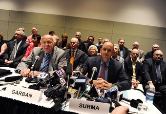 Chairman Steve Garban and Vice Chairman John P. Surma announce the firing of Joe Paterno in a Wednesday night press conference.