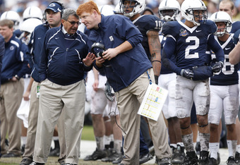 McQueary, pictured on the right next to Paterno, should be fired for his lack of action in the recent allegations surrounding Sandusky.