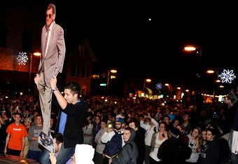 STATE COLLEGE, PA - NOVEMBER 9: Students and those in the community fill the streets and react after football head coach Joe Paterno was fired during the Penn State Board of Trustees Press Conference, in downtown Penn State, November 9, 2011 in State Coll