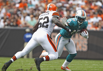 CLEVELAND, OH - SEPTEMBER 25:  Wide receiver Davone Bess #15 of the Miami Dolphins runs by linebacker D'Qwell Jackson #52 of the Cleveland Browns at Cleveland Browns Stadium on September 25, 2011 in Cleveland, Ohio.  (Photo by Matt Sullivan/Getty Images)