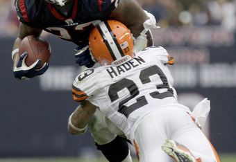 HOUSTON, TX - NOVEMBER 06: Running back Arian Foster #23 of the Houston Texans is tackled by defensive back Joe Haden #23 of the Cleveland Browns on November 6, 2011 at Reliant Stadium in Houston, Texas. (Photo by Thomas B. Shea/Getty Images)