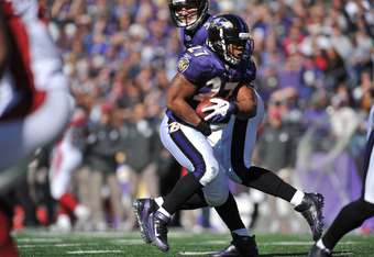 BALTIMORE - OCTOBER 30:  Ray Rice #27 of the Baltimore Ravens runs the ball against the Arizona Cardinals at M&T Bank Stadium on October 30. 2011 in Baltimore, Maryland. The Ravens defeated the Cardinals 30-27. (Photo by Larry French/Getty Images)