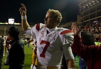 BOULDER, CO - NOVEMBER 4:  Quarterback Matt Barkley #7 of the USC Trojans celebrates after the Trojans' 42-17 win over the Colorado Buffaloes at Folsom Field on November 4, 2011 in Boulder, Colorado. (Photo by Justin Edmonds/Getty Images)