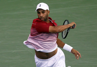 NEW YORK, NY - AUGUST 30:  James Blake of the United States returns a shot against Jesse Huta Galung of Netherlands during Day Two of the 2011 US Open at the USTA Billie Jean King National Tennis Center on August 30, 2011 in the Flushing neighborhood of t