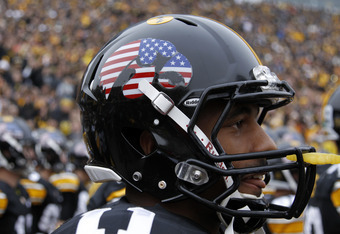 IOWA CITY, IA - NOVEMBER 5: Detail view of special American flag decal worn on the Iowa Hawkeyes helmets before the game against the at Michigan Wolverines at Kinnick Stadium on November 5, 2011 in Iowa City, Iowa. Iowa won 24-16. (Photo by Joe Robbins/Ge