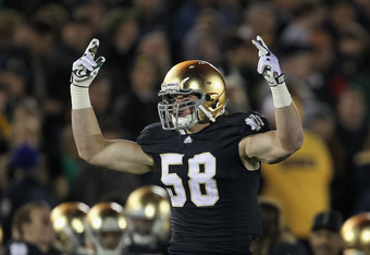 SOUTH BEND, IN - OCTOBER 22: Troy Niklas #58 of the Notre Dame Fighting Irish celebrates a touchdown return against the University of Southern California Trojans at Notre Dame Stadium on October 22, 2011 in South Bend, Indiana. USC defeated Notre Dame 31-