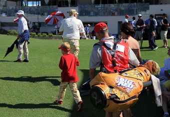 Daly walking off the course at the 2011 Australian Open
