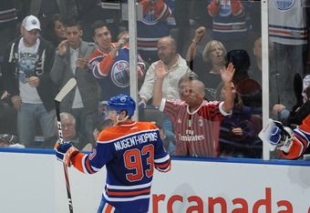 EDMONTON, CANADA - OCTOBER 9: 2011 1st overall draft pick Ryan Nugent-Hopkins #93 of the Edmonton Oilers celebrates his first ever NHL goal on Brent Johnson #1 of the Pittsburgh Penguins during third period action October 09, 2011 at the Rexall Place in E