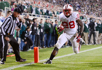 EAST LANSING, MI - OCTOBER 22:  Montee Ball #28 of the Wisconsin Badgers scores a game-tying touchdown in the fourth quarter against the Michigan State Spartans at Spartan Stadium on October 22, 2011 in East Lansing, Michigan. The Spartans defeated the Ba