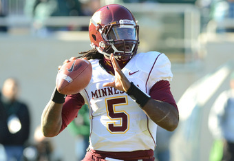 EAST LANSING, MI - NOVEMBER 05:  MarQueis Gray #5 of the Minnesota Golden Gophers looks to throw a pass in the fourth quarter of the game against the Michigan State Spartans at Spartan Stadium on November 5, 2011 in East Lansing, Michigan. The Spartans de