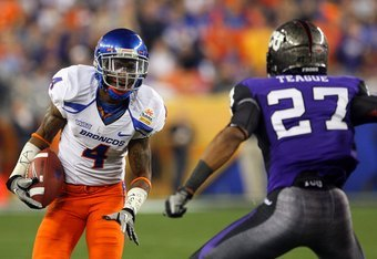GLENDALE, AZ - JANUARY 04:  Titus Young #4 of the Boise State Broncos runs after a catch against Jason Teague #27 of the TCU Horned Frogs during the Tostitos Fiesta Bowl at the Universtity of Phoenix Stadium on January 4, 2010 in Glendale, Arizona.  (Phot