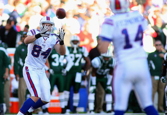 ORCHARD PARK, NY - NOVEMBER 06:Scott Chandler #84 of the Buffalo Bills makes a catch on a pass from Ryan Fitzpatrick #14 at Ralph Wilson Stadium on November 6, 2011 in Orchard Park, New York.New York won 27-11.  (Photo by Rick Stewart/Getty Images)