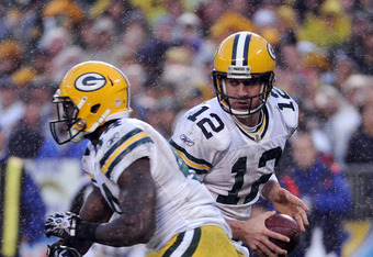 SAN DIEGO, CA - NOVEMBER 06:  Aaron Rodgers #12 of the Green Bay Packers fakes a handoff to  James Starks #44 during the game against the San Diego Chargers at Qualcomm Stadium on November 6, 2011 in San Diego, California.  (Photo by Harry How/Getty Image