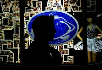 STATE COLLEGE, PA - NOVEMBER 10: On College Avenue, a passerby walks by a crying Penn State Nittany Lion window painting, November 10, 2011 in State College, Pennsylvania. Paterno was fired during the Penn State Board of Trustees Press Conference yesterda