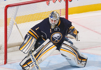 BUFFALO, NY - NOVEMBER 04:  Jhonas Enroth #1 of the Buffalo Sabres defends the net against the Calgary Flames at First Niagara Center on November 4, 2011 in Buffalo, New York.  (Photo by Rick Stewart/Getty Images)