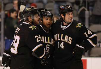 DALLAS, TX - OCTOBER 27:  (L-R) Steve Ott #29, Trevor Daley #6 and Jamie Benn #14 of the Dallas Stars celebrate a goal by Daley against the Los Angeles Kings at American Airlines Center on October 27, 2011 in Dallas, Texas.  (Photo by Ronald Martinez/Gett