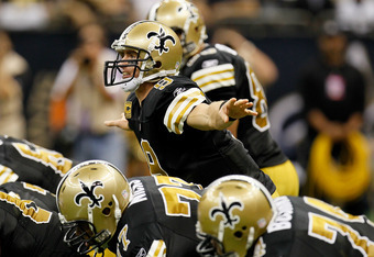 NEW ORLEANS, LA - NOVEMBER 06:  Drew Brees #9 of the New Orleans Saints yells to his offense against the Tampa Bay Buccaneers at Mercedes-Benz Superdome on November 6, 2011 in New Orleans, Louisiana.  (Photo by Kevin C. Cox/Getty Images)